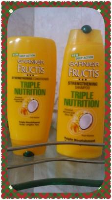 My pretty Garnier Fructis bottles  of my bathroom shelf